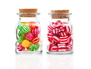 two filled glass candy jars isolated over white background