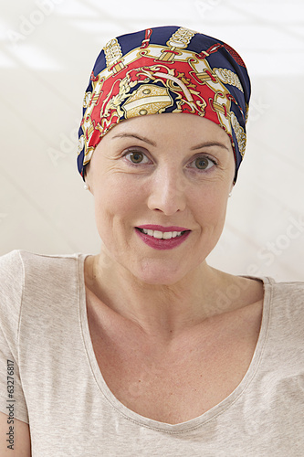 woman with headscarf after cancer treatment