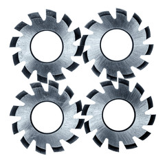 Four circular cutter blades over white