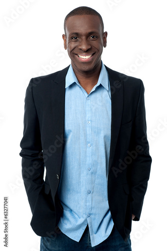 Businessman posing with hands in pocket
