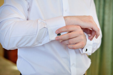men wear a shirt and cufflinks
