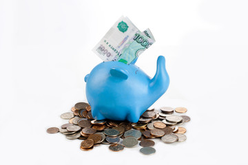 piggy bank with coins mountain