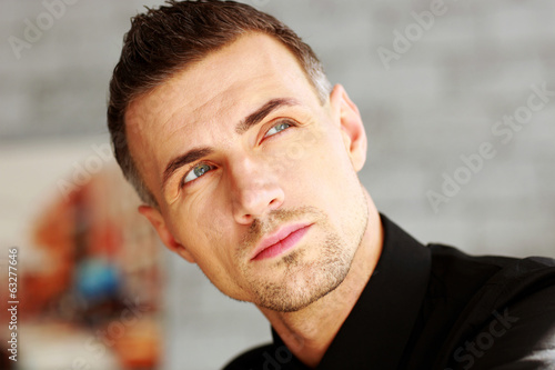 Closeup portrait of a businessman looking up