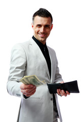 Happy businessman giving US dollars at you
