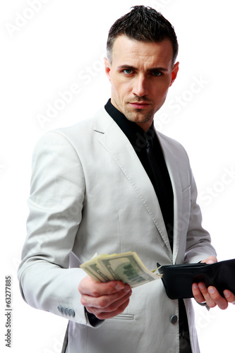 Confident businessman giving US dollars at you