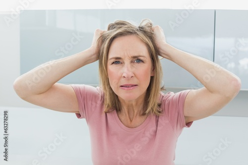 Displeased woman pulling her hair