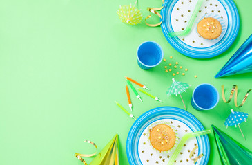 Boy birthday decorations on green table