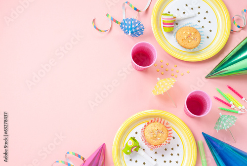 Girl birthday decorations on pink table - 63278437