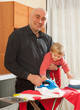 dad with baby   ironing