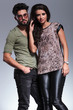 couple posing for the camera in studio