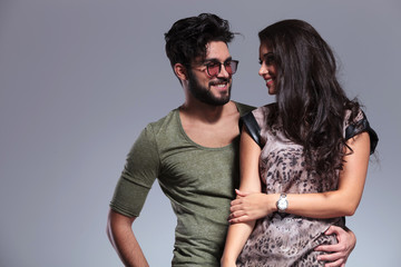 young casual couple smiling to each other