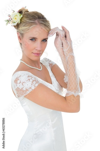 Sensuous bride posing over white background