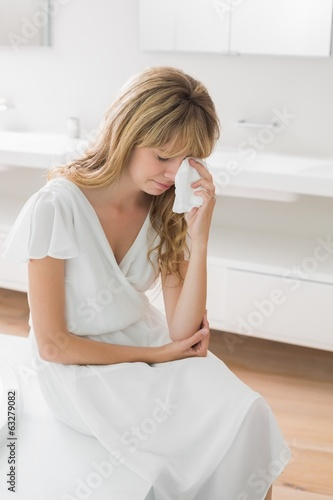 Sad woman crying in the bathroom