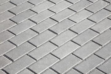 gray paving stones on the sidewalk