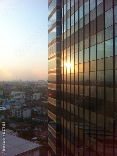 sunset on high building mirror