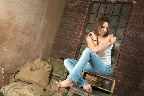 Beautiful woman in an old warehouse