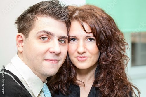 Closeup portrait of beautiful happy couple