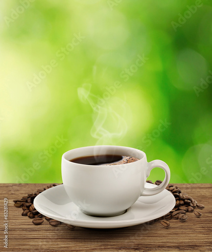 Coffee cup and saucer on a wooden table (clipping path).