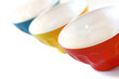 Three colored bowls on white background