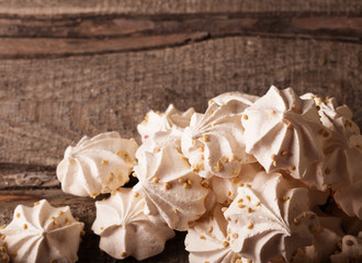 meringue cookies on wooden background