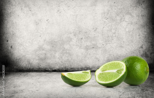 Fresh ripe lime on gray concrete floor