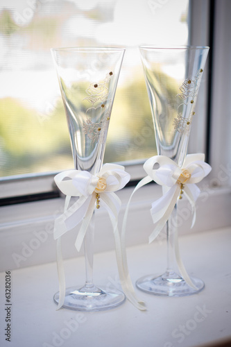 Two empty wedding champagne glasses