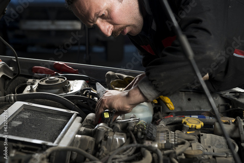 Auto repairman at garage