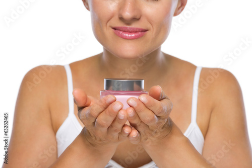 Closeup on young woman enjoying creme