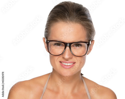 Portrait of young woman in eyeglasses