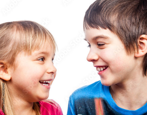 Sister and brother laughing