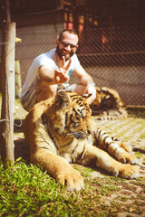 Man holding ears to the tiger