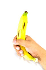 Banana in hand on white background