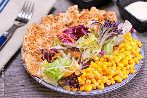 Chicken salad with mixed green and sweet corn
