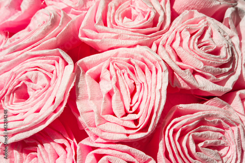 Pink roses from crepe paper. Decorative flowers. Closeup.
