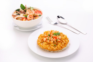 Tom Yum Soup, fried omelet topped on rice