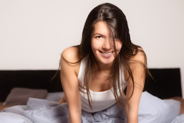 Refreshed young woman awaking in the morning