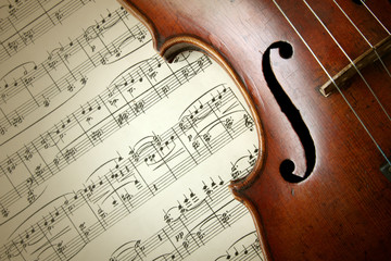 Detail of old scratched violin on music sheet