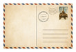 Old style postcard or envelope with postage stamp isolated