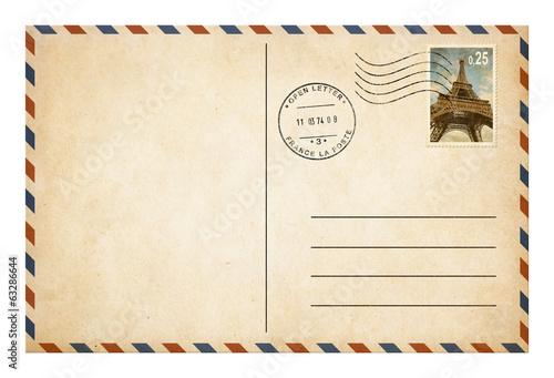 Leinwandbild Motiv Old style postcard or envelope with postage stamp isolated