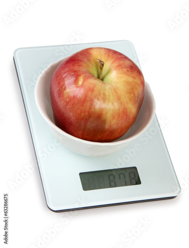 Apple on white scales