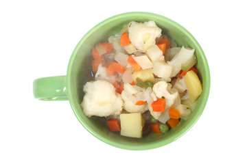 Vegetable soup in ceramic cup