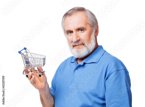 Cheerful senior man holding shopping cart