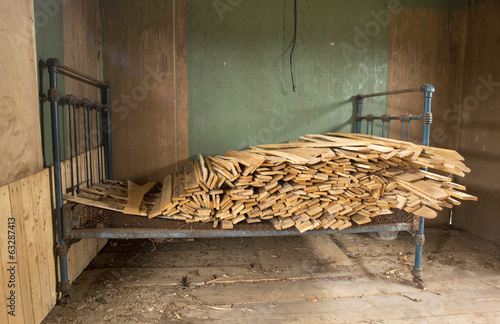 Framework of bed with dumped firewood