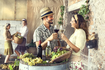 farmers couple drinking wine in a farm