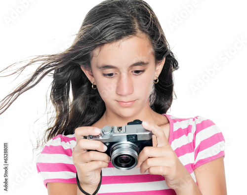 Young girl looking at images taken on a compact camera