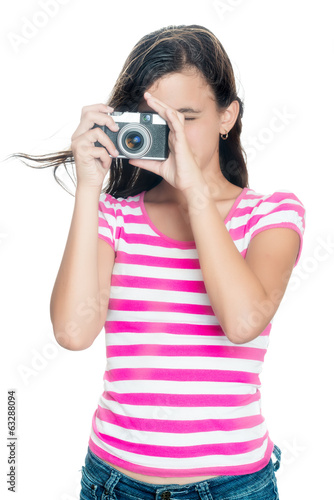 Cute young girl taking a photo isolated on white