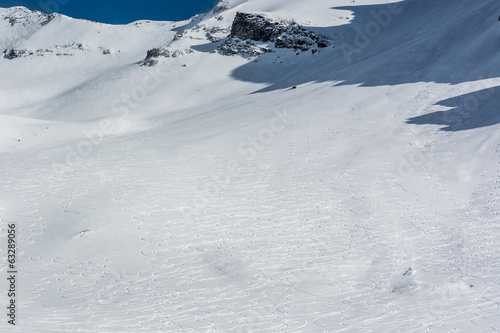 Mountain slope with ski tracks