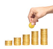 Savings, increasing columns of gold coins and man hand