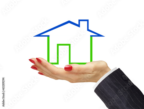 Green house in woman hand isolated on white background. Real est