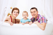 Happy couple with son sitting in bathtub